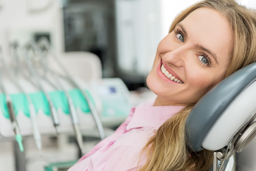 Smiling patient in dental chair after getting a cosmetic dental procedure at Salem Dentist at Fairmount Dental Center.