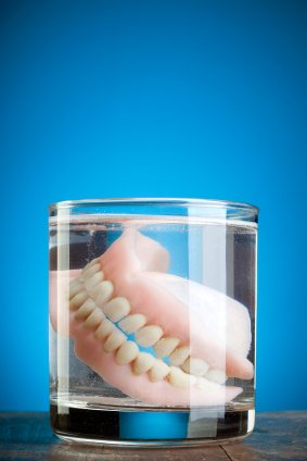 Dentures from Fairmount Dental Center in Salem, OR soaking in water